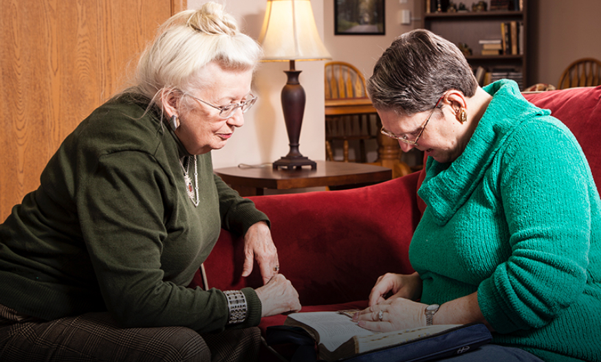 Two woman looking at a book